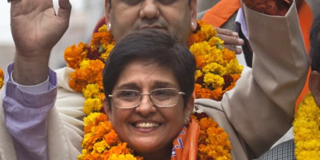 Bharatiya Janata Party chief ministerial candidate Kiran Bedi waves during a road show before filing her nomination papers for the Delhi state elections in New Delhi, India, Wednesday, Jan. 21, 2015. Delhi state will go for polls on February 7. (AP Photo/Tsering Topgyal)