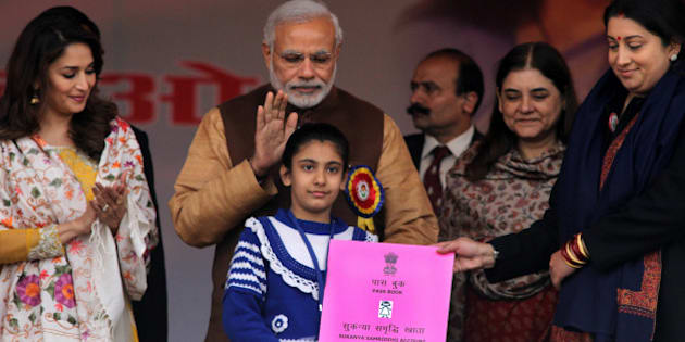 PANIPAT, INDIA - JANUARY 22: Prime Minister Narendra Modi along with film actress Madhuri Dixit, Union Minister for Women and Child Development Maneka Gandhi and HRD Minister Smriti Irani present Sukanya Samriddhi account pass-book to a girl at launch of Beti Bachao Beti Padhao programme on January 22, 2015 in Panipat, India. The Beti Bachao Beti Padhao campaign, which means Save the girl child, educate the girl child, aims to address the issue of declining Child Sex Ratio (CSR) through a mass campaign across the country targeted at changing societal mindsets and creating awareness about the criticality of the issue. (Photo by Ravi Kumar/Hindustan Times via Getty Images)