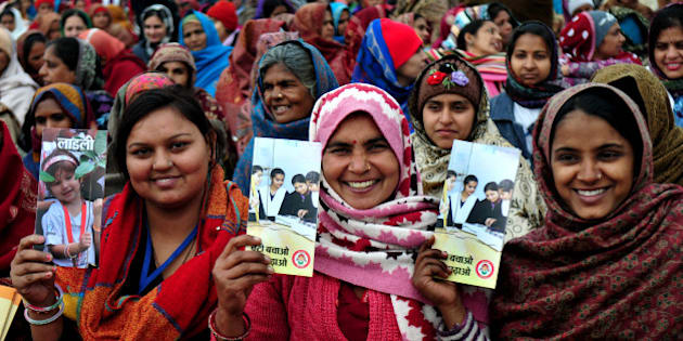 PANIPAT, INDIA - JANUARY 22: Ladies in crowd holding brochures at launch of Beti Bachao Beti Padhao programme on January 22, 2015 in Panipat, India. The Beti Bachao Beti Padhao campaign, which means Save the girl child, educate the girl child, aims to address the issue of declining Child Sex Ratio (CSR) through a mass campaign across the country targeted at changing societal mindsets and creating awareness about the criticality of the issue. (Photo by Ravi Kumar/Hindustan Times via Getty Images)