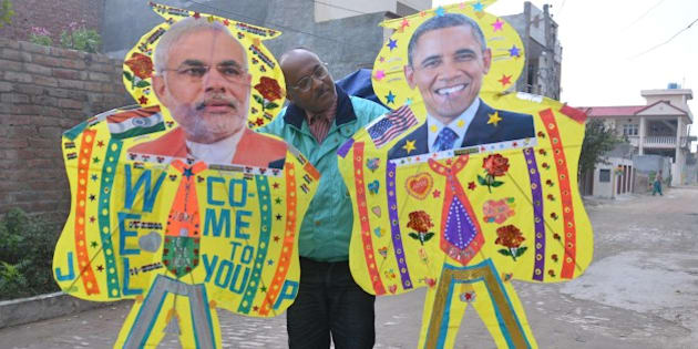 AMRITSAR, INDIA - JANUARY 21: An Indian kitemaker poses with kites adorned with images of US President Barack Obama (R) and Indian Prime Minister Narendra Modi (L) on January 21, 2015 in Amritsar, India.  Barack Obama arrives in India this weekend for an unprecedented second visit by a serving US president, the honoured guest of Prime Minister Narendra Modi who was still a Washington outcast a year ago. (Photo by Sameer Sehgal/Hindustan Times via Getty Images)