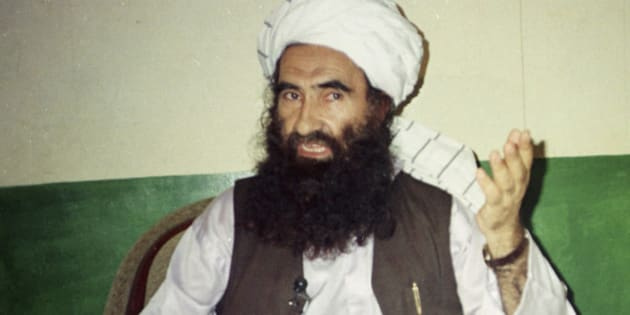 FILE - In this Aug. 22, 1998, file photo, Jalaluddin Haqqani, then the Taliban Army Supreme Commander, talks to reporters in Miram Shah, Waziristan, Pakistan. One of the deadliest militant groups in Afghanistan, the Haqqani network, has developed a sophisticated, mafia-style financing operation that relies on illegal activities, such as extortion, kidnapping and smuggling, and ties to legitimate businesses, according to a new report by a U.S.-based think tank. (AP Photo/Mohammad Riaz, File)