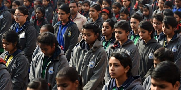 Indian schoolchildren pray during an assembly at their school in New Delhi on December 17, 2014, as they pay tribute to slain Pakistani schoolchildren and staff after an attack on an army-run school in the restive city of Peshawar. Pakistan began three days of mourning on December 17 for the 132 schoolchildren and nine staff killed by the Taliban in the country's deadliest ever terror attack as the world united in a chorus of revulsion. The 141 people were killed when insurgents stormed an army-run school in the northwestern city of Peshawar and systematically went from room to room shooting children during an eight-hour killing spree. AFP PHOTO / SAJJAD HUSSAIN        (Photo credit should read SAJJAD HUSSAIN/AFP/Getty Images)