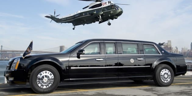 Marine One helicopter, carrying US President Barack Obama, prepares to land next to the Presidential limousine, known as 'The Beast,' at the Wall Street landing zone in New York City, March 11, 2014, prior to attending Democratic fundraisers and stopping at a Gap clothing store to highlight his proposal to raise the federal minimum wage. AFP PHOTO / Saul LOEB        (Photo credit should read SAUL LOEB/AFP/Getty Images)