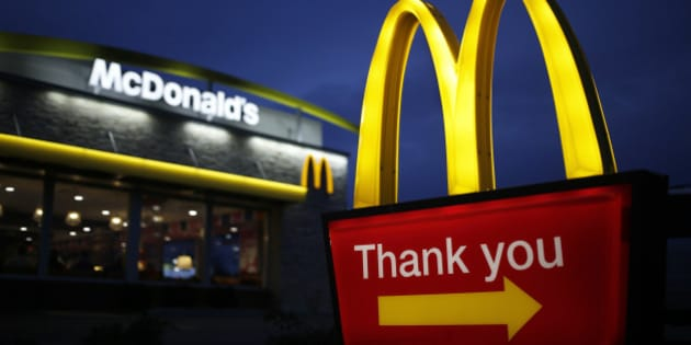 Golden arches mark the entrance to a McDonald's Corp. restaurant in Shelbyville, Kentucky, U.S., at dawn on Friday, Jan. 23, 2015. McDonald's Corp., the world's largest restaurant chain, posted same-store sales that declined less than analysts expected as menu changes started to turn around results in the U.S. Photographer: Luke Sharrett/Bloomberg via Getty Images