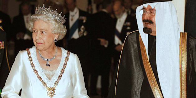 King Abdullah of Saudi Arabia, right, with Queen Elizabeth II, prior a state banquet at Buckingham Palace in London after the first day of the Saudi king's visit Tuesday Oct. 30, 2007. Britain's lavish welcome for Saudi Arabia's King Abdullah came under heavy criticism Tuesday from scathing newspaper editorials, protesters raising concerns over human rights abuses and an opposition party boycotting the visit.  (AP Photo/John Stillwell, Pool)