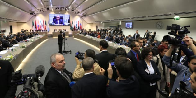 Members of the media cover the 164th OPEC (Organization of the Petroleum Exporting Countries) meeting in Vienna, on December 4, 2013. OPEC is set to stick to its oil output limit at a meeting here, even as Iraq and Iran eye higher crude exports amid slashed Libyan production. AFP PHOTO / ALEXANDER KLEIN        (Photo credit should read ALEXANDER KLEIN/AFP/Getty Images)