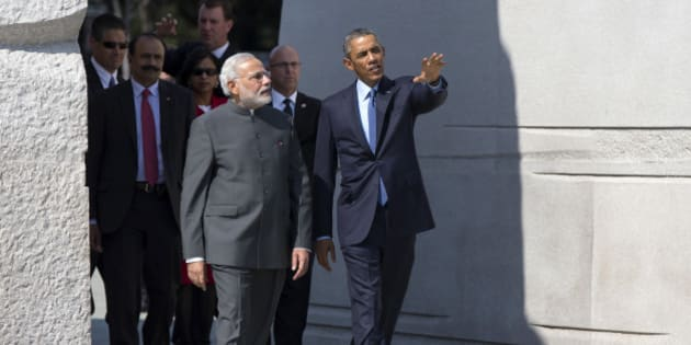 """President Barack Obama escorts Indian Prime Minister Narendra Modi at the Martin Luther King Jr. Memorial in Washington, Tuesday, Sept. 30, 2014. President Barack Obama and India's new Prime Minister Narendra Modi said Tuesday that """"it is time to set a new agenda"""" between their countries, addressing concerns that the world's two largest democracies have grown apart. (AP Photo/Evan Vucci)"""