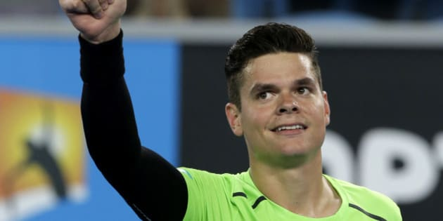 Milos Raonic of Canada celebrates after defeating Donald Young of the U.S. during their second round match at the Australian Open tennis championship in Melbourne, Australia, Thursday, Jan. 22, 2015. (AP Photo/Lee Jin-man)