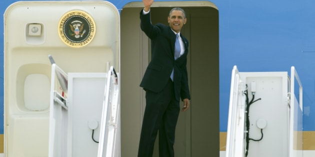 President Barack Obama waves as he boards Air Force One at Andrews Air Force Base, Md. Tuesday, April 22, 2014, for a flight to Oso, Washington to visit with victims of the deadly March 22 disaster, emergency responders and recovery workers.  (AP Photo/Cliff Owen)