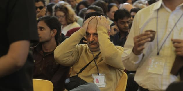"""A visitor reacts when he hears the news of Indian born British author Salman Rushdie's video conference being called off at the Jaipur Literature Festival, in Jaipur, in the western Indian state of Rajasthan, Tuesday, Jan. 24, 2012. The organizers of the Indian literary festival called off a video conference with British author Salman Rushdie following protests by Muslim groups who considered his 1988 book """"The Satanic Verses"""" blasphemous. (AP Photo/ Manish Swarup)"""