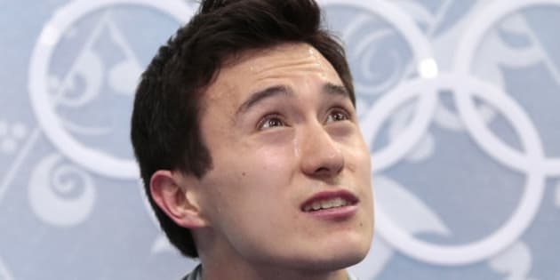 Patrick Chan of Canada sits in the results area after the men's free skate figure skating final at the Iceberg Skating Palace at the 2014 Winter Olympics, Friday, Feb. 14, 2014, in Sochi, Russia. (AP Photo/Ivan Sekretarev)
