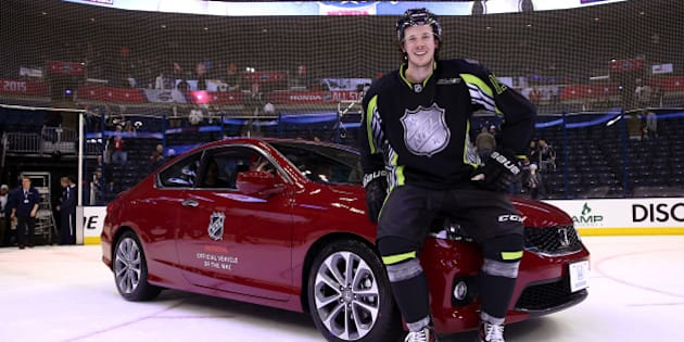 COLUMBUS, OH - JANUARY 25:  Ryan Johansen #19 of the Columbus Blue Jackets and Team Foligno poses next to a Honda after being named MVP of the 2015 Honda NHL All-Star Game at Nationwide Arena on January 25, 2015 in Columbus, Ohio.  (Photo by Bruce Bennett/Getty Images)