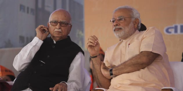 Gujarat state chief minister and Bharatiya Janata Party's prime ministerial candidate Narendra Modi, right, and senior leader Lal Krishna Advani sit during party workers convention after inaugurating the party's new state headquarters building in Gandhinagar, India, Monday, Feb. 10, 2014. (AP Photo/Ajit Solanki)