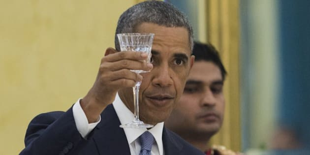 US President Barack Obama makes a toast during a State Dinner at Rashtrapati Bhawan, the Presidential Palace, in New Delhi, India, January 25, 2015. AFP PHOTO / SAUL LOEB        (Photo credit should read SAUL LOEB/AFP/Getty Images)