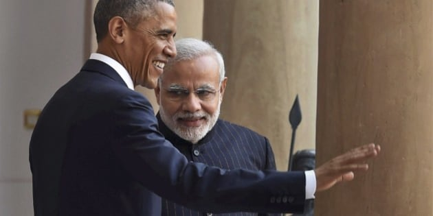 "U.S. President Barack Obama, left and Indian Prime Minister Narendra Modi pose for the media before they held their talks, in New Delhi, India, Sunday, Jan. 25, 2015. Seizing on their personal bond, Obama and Modi said Sunday they had made progress on nuclear cooperation and climate change, with Obama declaring a ""breakthrough understanding"" in efforts to free U.S. investment in nuclear energy development in India. (AP Photo/Press Trust of India) INDIA OUT"
