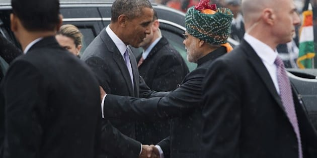 Indian Prime Minister Narendra Modi (2R) greets US President Barack Obama (2L) as he arrives to attend India's Republic Day Parade in New Delhi on January 26, 2015. Barack Obama will become the first US president to be chief guest at India's Republic Day parade on January 26, a day after hailing a new era of friendship between the world's biggest democracies. AFP PHOTO / SAUL LOEB        (Photo credit should read SAUL LOEB/AFP/Getty Images)