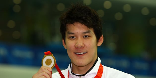 BEIJING - AUGUST 10:  Park Taehwan of South Korea poses with the gold medal during the medal ceremony for the Men's 400m Freestyle event held at the National Aquatics Center during day 2 of the Beijing 2008 Olympic Games on August 10, 2008 in Beijing, China.  (Photo by Shaun Botterill/Getty Images)