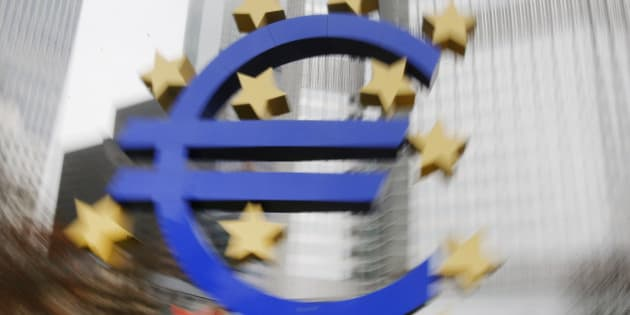 In this picture taken while moving  the camera,  the  Euro sculpture stands in front of the old European Central Bank in Frankfurt, Germany, Monday, Jan. 26, 2015.  The euro wobbled Monday after Greece's anti-austerity opposition party won a big victory in national elections, renewing fears the European common currency bloc could unravel. (AP Photo/Michael Probst)