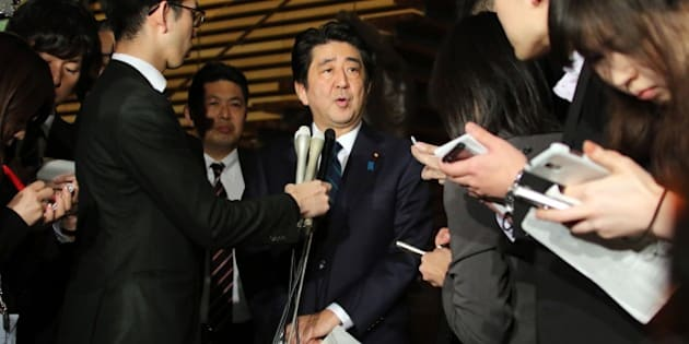 Japanese Prime Minister Shinzo Abe speakes to reporters after a cabinet meeting at his official residence in Tokyo on January 25, 2015. Japan's government said it was attempting to verify a video posted online announcing the execution of one of two Japanese hostages held captive by Islamic State militants. 'A new video apparently showing Kenji (Goto) was posted on the Internet,' chief government spokesman Yoshihide Suga said. 'We are collecting information'.  AFP PHOTO / Yoshikazu TSUNO        (Photo credit should read YOSHIKAZU TSUNO/AFP/Getty Images)