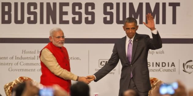 """U.S. President Barack Obama, right waves to the audience as he and Indian Prime Minister Narendra Modi attend the India-U.S business summit in New Delhi, India, Monday, Jan. 26, 2015. Obama urged business leaders to find ways to seize the """"untapped potential"""" that could unleash greater trade between the U.S. and India. (AP Photo/Saurabh Das)"""