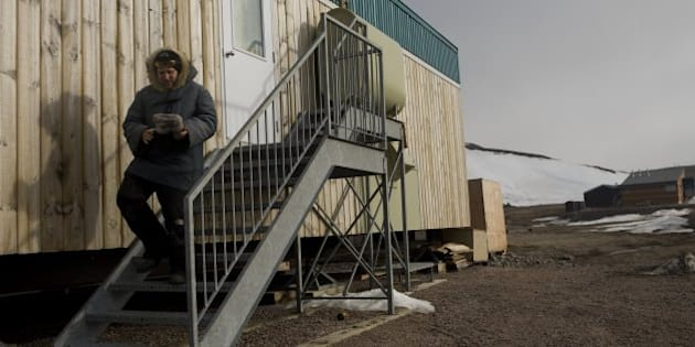 IVUJIVIK, CANADA - JUNE 2 : Laurent Bisbrouck exits his house on June 2, 2008 in Ivujivik, Canada. Bisbrouck has lived in the northern most village in Quebec for the last 14 years serving as a nurse for village with a population of 350.   (Photo by Marvi Lacar/Getty Images)