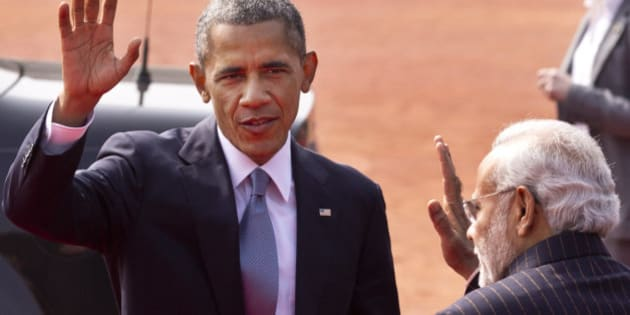 U.S. President Barack Obama waves to the media, with Indian Prime Minister Narendra Modi standing beside him during a ceremonial reception at the Indian Presidential Palace in New Delhi, India, Sunday, Jan. 25, 2015. Obama is the first American leader to be invited to attend India's Republic Day festivities, which commence Monday and mark the anniversary of the enactment of the country's democratic constitution. (AP Photo/Saurabh Das)