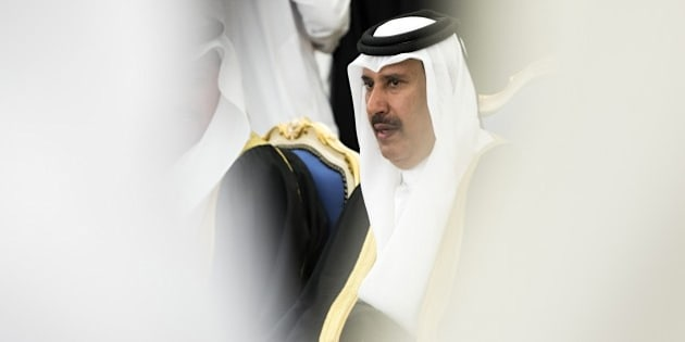 Qatari former Prime Minister Sheik Hamad bin Jassem bin Jabr al-Thani attends a ceremony with dignitaries and leaders from around the world offering their condolences to new King Salman on January 24, 2015 at the Diwan royal palace in Riyadh, Saudi Arabia, a day after the death of King Abdullah. One after another, foreign aircraft landed at a Riyadh military base where leaders from Africa, Europe and Asia descended a red-carpeted ramp to be welcomed by officials and served a traditional tiny cup of Arabic coffee. AFP PHOTO / POOL / YOAN VALAT        (Photo credit should read YOAN VALAT/AFP/Getty Images)