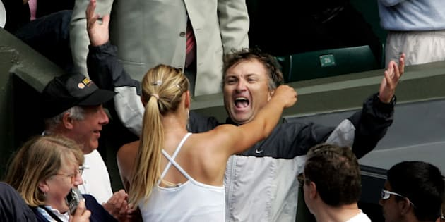 LONDON - JULY 3: Maria Sharapova of Russia hugs her father Yuri as she celebrating winning the ladies final match against Serena Williams of USA at the Wimbledon Lawn Tennis Championship on July 3, 2004 at the All England Lawn Tennis and Croquet Club in London. Sharapova won 6-1 6-4.  (Photo by Phil Cole/Getty Images)