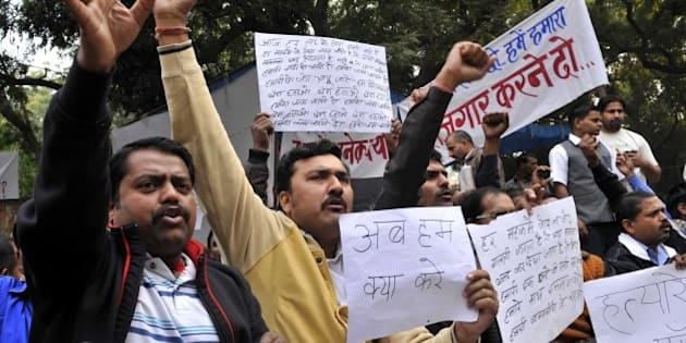 NEW DELHI, INDIA - DECEMBER 12: Hundreds of cab drivers employed with the internet-based taxi firm Uber came out to protest against cancelling of Uber services, demanding revocation of the ban imposed on the company's operations, at Jantar Mantar on December 12, 2014 in New Delhi, India. (Photo by Saumya Khandelwal/Hindustan Times via Getty Images)