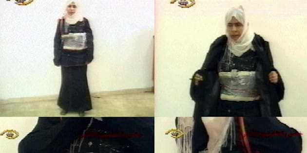 Amman, JORDAN:  (FILES) TV grabs taken from the Jordanian TV shows Iraqi Sajida Mubarak al-Rishawi, 35, who accompanied her husband on a suicide mission in Amman and failed to detonate her explosive belt, displaying her belt during a televised confession 13 November 2005. A Jordanian military court sentenced Rishawi to death during a trial in Amman 21 September 2006. 'The court has decided to sentence to death by hanging Sajida al-Rishawi for conspiracy to carry out terror acts' that lead to the death of 60 individuals in the November 2005 bombings, the head of the court said today. Rishawi, dressed in blue with a black scarf covering her head, remained impassive.  AFP PHOTO/JORDANIAN TV  (Photo credit should read -/AFP/Getty Images)
