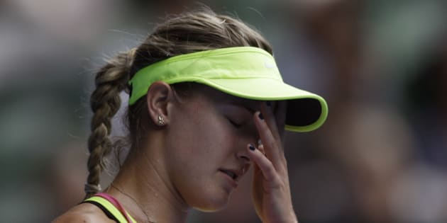 Eugenie Bouchard of Canada reacts as she plays Maria Sharapova of Russia during their quarterfinal match at the Australian Open tennis championship in Melbourne, Australia, Tuesday, Jan. 27, 2015. (AP Photo/Bernat Armangue)