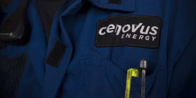 A Cenovus Energy Inc. logo is displayed on an employee's uniform at Christina Lake, a situ oil production facility half owned by Cenovus Energy Inc. and ConocoPhillips, in Conklin, Alberta, Canada, on Thursday, Aug. 15, 2013. Cenovus Energy Inc. is Canada's fourth-largest oil producer. Photographer: Brent Lewin/Bloomberg via Getty Images