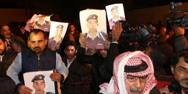 AMMAN, JORDAN - JANUARY 28: Jordanian pilot Maaz al-Kassasbeh's relatives stage a demonstration in front of the Royal Palace, demanding the release of Sajida al-Rishawi in Amman, Jordan on January 28, 2015. Islamic State of Iraq and Levant (ISIL) threatened to kill al-Kassasbeh and a Japanese journalist within 24 hours if Jordan will not release the jailed Iraqi militant al-Rishawi. (Photo by Salah Malkawi/Anadolu Agency/Getty Images)