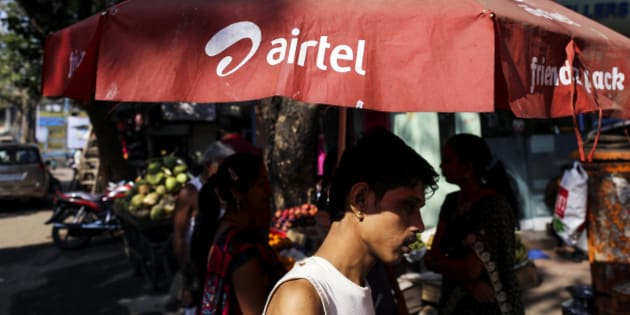 The logo of Bharti Airtel Ltd. is displayed on a parasol in Mumbai, India, on Wednesday, Jan. 29, 2014. India got bids totaling 446.1 billion rupees ($7.12 billion) on the first day of a wireless spectrum auction on Feb. 3, the third effort by the government to raise revenue from the sale of airwaves in the last 15 months. Photographer: Dhiraj Singh/Bloomberg via Getty Images