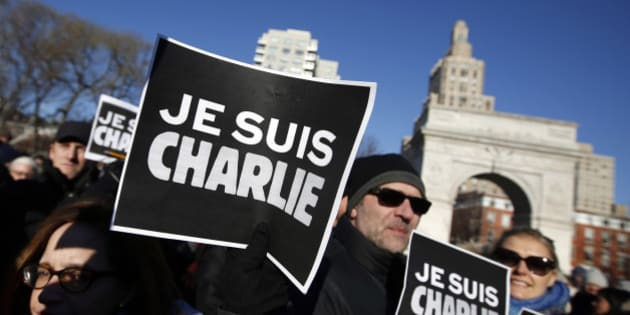 "Attendees hold ""Je Suis Charlie"" (I am Charlie) signs as several hundred people gather in solidarity with victims of two terrorist attacks in Paris, one at the office of weekly newspaper Charlie Hebdo and another at a kosher market, in New York's Washington Square Park, Saturday, Jan. 10, 2015. (AP Photo/Jason DeCrow)"