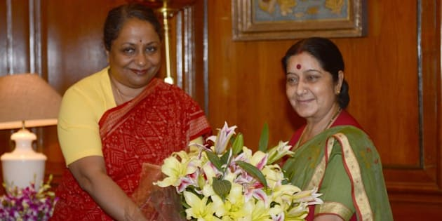 India's newly appointed Minister of External Affairs Sushma Swaraj (R) is welcomed by Indian Foreign Secretary Sujata Singh as she arrives for her first day at office in New Delhi on May 28, 2014.   New Indian Prime Minister Narendra Modi announced his cabinet May 27, combining several portfolios to cut the number of government positions and giving many regional politicians their first national experience.  AFP PHOTO/RAVEENDRAN        (Photo credit should read RAVEENDRAN/AFP/Getty Images)