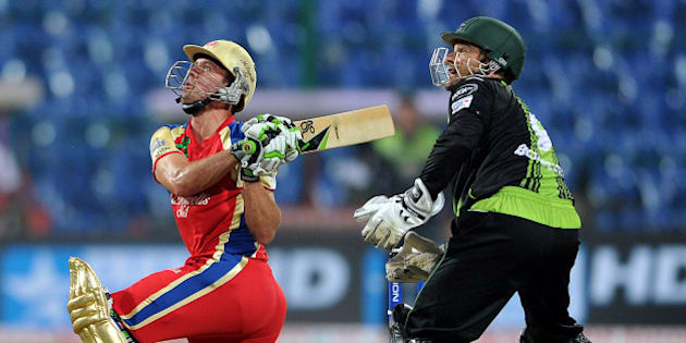Royal Challengers Bangalore player AB De Villiers plays a shot against the Warrior's during the Champions League Cricket Twenty20 League group B match at the M. Chinnaswamy Stadium in Bangalore on September 23, 2011. AFP PHOTO/Manjunath KIRAN (Photo credit should read Manjunath Kiran/AFP/Getty Images)