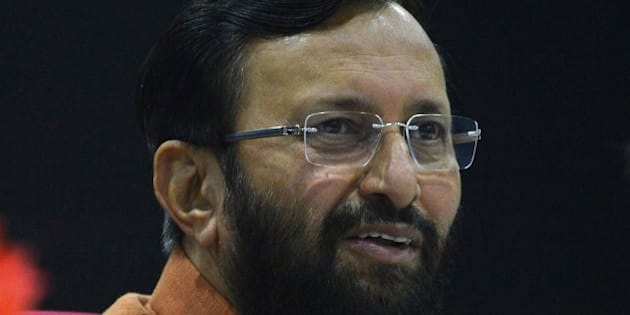 Prakash Javadekar, Indian Union Minister for Environment and Forests, speaks to media at a press conference in New Delhi on December 5, 2014. India will not sign any deal to cut greenhouse gas emissions at UN climate talks that threatens its growth or undermines its fight against poverty, the environment minister said December 5. AFP PHOTO / CHANDAN KHANNA        (Photo credit should read Chandan Khanna/AFP/Getty Images)
