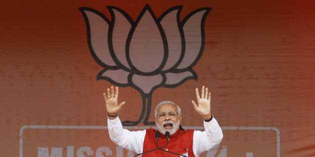 Indian Prime Minister Narendra Modi addresses an election campaign rally in Kathua, about 90 kilometers from Jammu, India, Saturday, Dec.13, 2014. The final two phases of the five-phased state elections of Jammu and Kashmir will be held on Dec. 14 and 20. (AP Photo/Channi Anand)