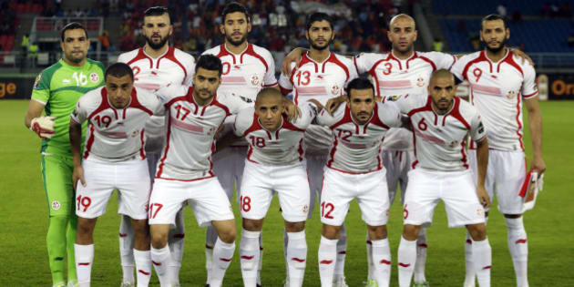 Tunisia national soccer team line up before their African Cup of Nations Group B soccer against DR Congo in Bata, Equatorial Guinea, Monday, Jan. 26, 2015. (AP Photo/Themba Hadebe)