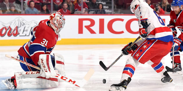 MONTREAL, QC - JANUARY 31: Carey Price #31 of the Montreal Canadiens makes a save off the shot by Jay Beagle #83 of the Washington Capitals in the NHL game at the Bell Centre on January 31, 2015 in Montreal, Quebec, Canada. (Photo by Francois Lacasse/NHLI via Getty Images)
