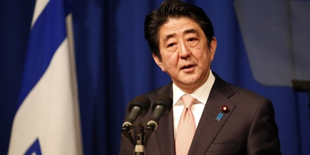 Japanese Prime Minister Shinzo Abe speaks during a press conference at a hotel in Jerusalem on January 20, 2015, demanding that the Islamic State group immediately free two Japanese hostages unharmed after the jihadists posted a video threat to kill them. The Islamic State group threatened to kill the two Japanese hostages unless Tokyo pays a $200 million ransom within 72 hours to compensate for non-military aid that  Abe pledged to support the campaign against IS during an ongoing Middle East. AFP PHOTO / THOMAS COEX        (Photo credit should read THOMAS COEX/AFP/Getty Images)