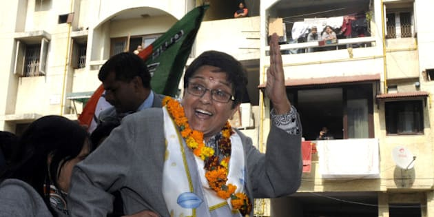 NEW DELHI, INDIA  JANUARY 29: BJP Chief Ministerial Candidate Kiran Bedi waves to voters during the campaigning for Delhi Assembly elections in the Geeta Colony Area on January 29, 2015 in New Delhi, India. Polling in Delhi will be held on February 7 and the counting of votes will take place on February 10. (Photo by Sonu Mehta/Hindustan Times via Getty Images)