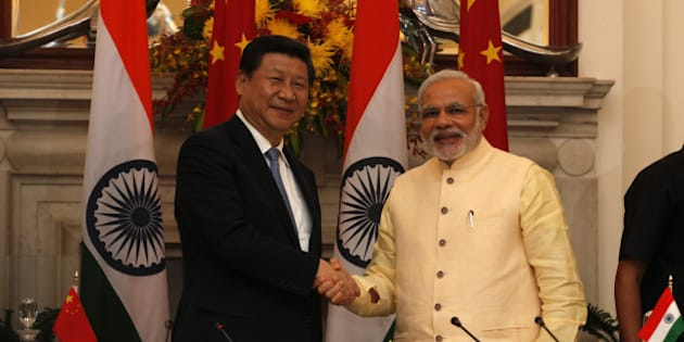 NEW DELHI, INDIA - SEPTEMBER 18: Prime Minister Narendra Modi and Chinese President Xi Jinping shake hands at the agreement signing ceremony at Hyderabad House on September 18, 2014 in New Delhi, India.  India and China inked 12 pacts in a range of areas including railways and outer space as Beijing pledged investments of USD 20 billion over five years in a bid to boost economic ties and address Indias concerns over trade deficit. (Photo by Arvind Yadav/Hindustan Times via Getty Images)