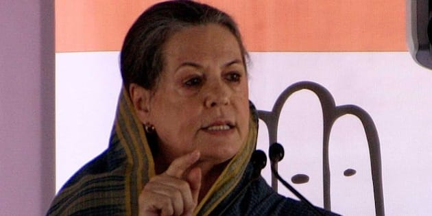 ROHTAK, INDIA - OCTOBER 4: Congress president Sonia Gandhi addresses during an election rally at Meham village on October 4, 2014 in Rothak, India. Accusing Modi government of hijacking policies of previous Congress regimes, she urged the people not to get swayed by 'hollow promises' and said that Congress was the only party which would ensure that development continues in Haryana. (Photo by Manoj Dhaka/Hindustan Times via Getty Images)