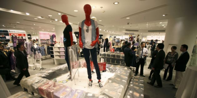 Guests look around interior of the largest global flagship store of Uniqlo  during its pre-opening Thursday, May 13, 2010 in Shanghai, China. The UNIQLO Shanghai Global Flagship Store will open on May 15 officially. (AP Photo/Eugene Hoshiko)