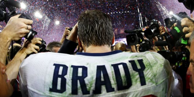 GLENDALE, AZ - FEBRUARY 01:  Tom Brady #12 of the New England Patriots is surrounded by the media after defeating the Seattle Seahawks 28-24 during Super Bowl XLIX at University of Phoenix Stadium on February 1, 2015 in Glendale, Arizona.  (Photo by Tom Pennington/Getty Images)