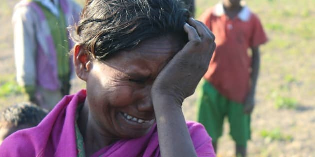 An Indian villager mourns the death of a relative in Phulbari in Sonitpur district, some 250kms east of Guwahati on December 24, 2014, after heavily armed militants launched a series of coordinated attacks in rural Assam, pulling villagers from their homes and shooting them at point-blank range, witnesses said. Violence in the restive Indian state of Assam has killed 68 people including 12 children, authorities said, as separatist rebels dramatically intensified a long-running campaign in the tea-growing area. AFP PHOTO/STR        (Photo credit should read STRDEL/AFP/Getty Images)