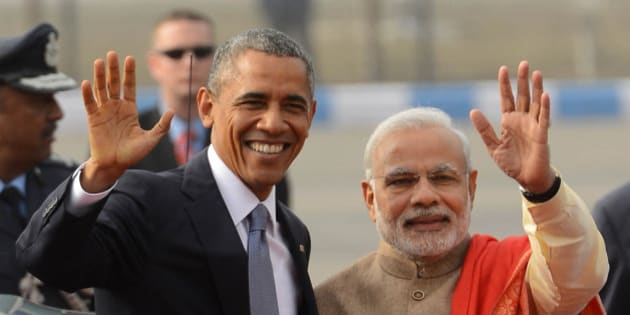 NEW DELHI, INDIA  JANUARY 26: Prime Minister Narendra Modi with visiting US President Barack Obama waves upon his  arrival in New Delhi.(Photo by Shekhar Yadav/India Today Group/Getty Images)