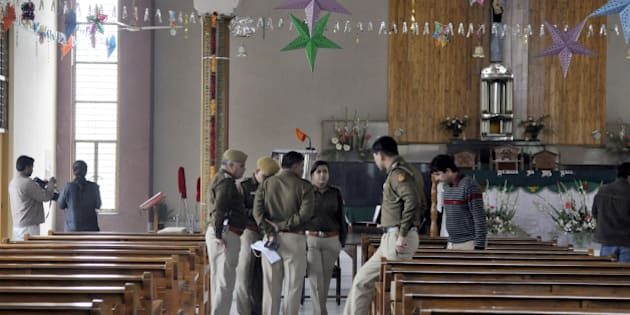 NEW DELHI, INDIA - FEBRUARY 2: Delhi Police officers investigate after attack on St Alphonsas church at Vasant Kunj on February 2, 2015 in New Delhi, India. The fifth attack on a church since December comes just five days before assembly elections. (Photo by Sonu Mehta/Hindustan Times via Getty Images)
